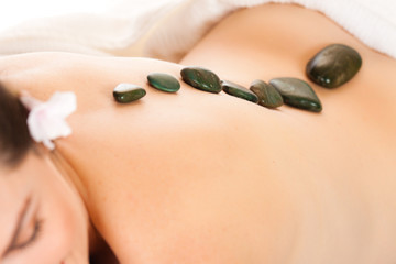 Fit woman getting a hot stone massage