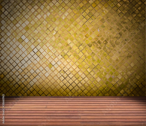 golden mosaic wall and wood floor
