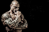 Handsome Bodybuilder With Bodyart - 38666100
