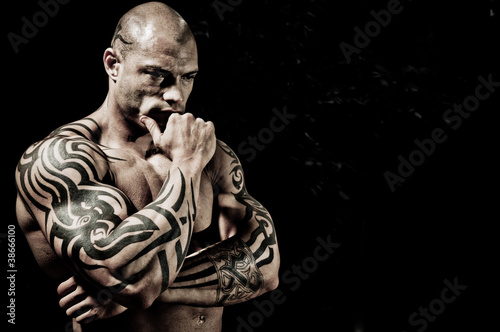 Handsome Bodybuilder With Bodyart