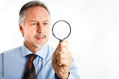 Businessman searching for something