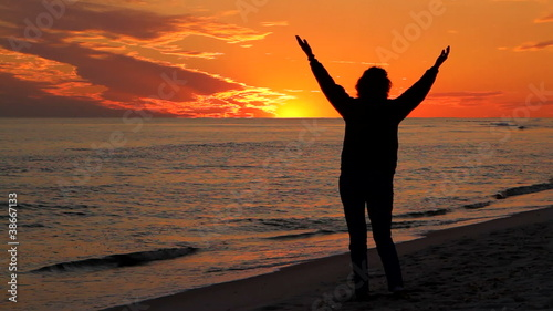 Woman Praising At Sunset
