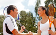 Tennis couple handshaking