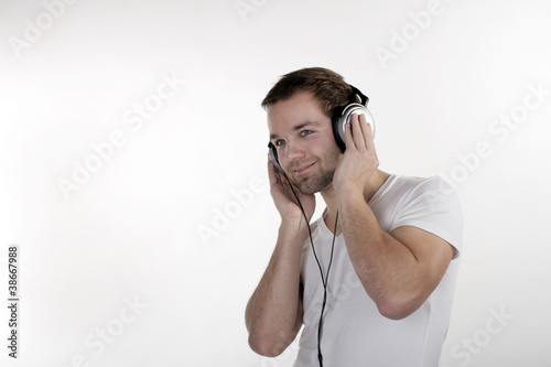 A young man listening to music