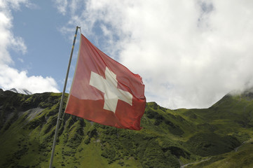 Swiss flag in front of hills around Allmendhubel