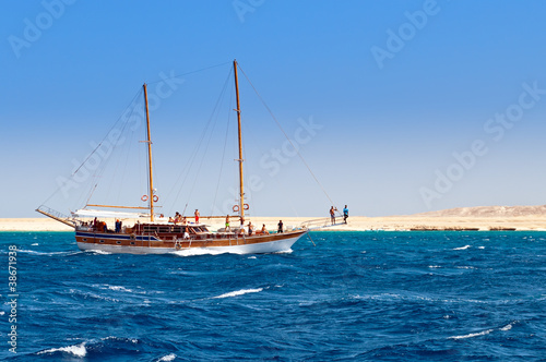 Sailboat on the coastline background