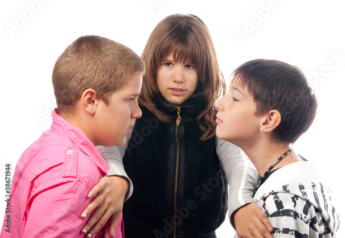 Teenage girl and two angry teenage boys that want to fight