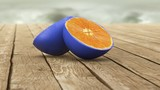 blue skin orange on wooden table