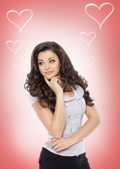 Valentines Day. Beautiful girl woman with heart sign