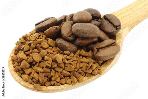 Ground coffee with coffee beans in wooden spoon