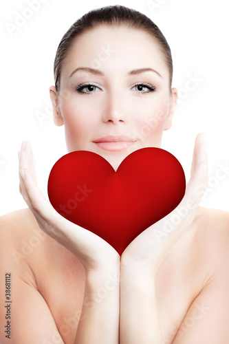 Beautiful woman holding big red heart