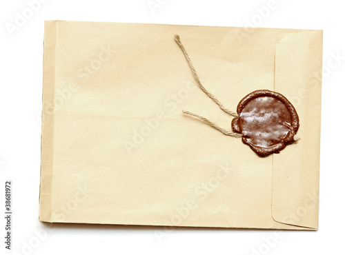 red wax seal on yellow envelope