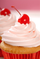 Vanilla cupcake with maraschino frosting and cherry