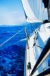 Yacht Sailing against sunset. Sailboat