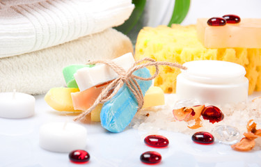 Handmade soap with cream and towels