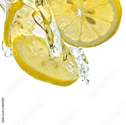 Lemon slices in water splash, white background, isolated