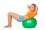 Young woman on gymnastic ball