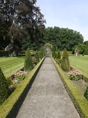 A path in perspective in a romantic garden