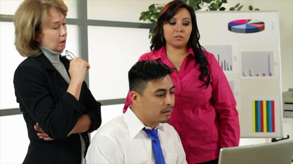 A mature business woman and two young Hispanic co-workers