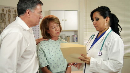 Hispanic Woman Doctor Talking to Couple