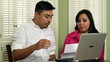 Young Hispanic Couple Going Over Finances