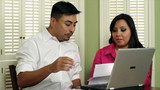 Young Hispanic Couple Going Over Finances