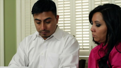 Stressed Mexican American Couple Disscuss Bills