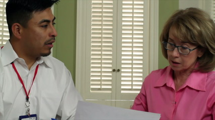 Latino Salesman Talking to Mature Caucasian Woman