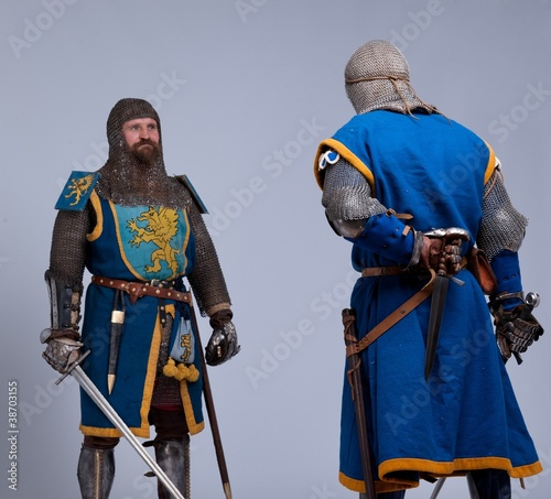 Two medieval knights preparing to fight.