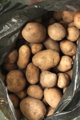 Overflowing bag of potatos