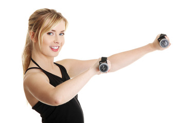 Young attractive female exercise using dumbbell