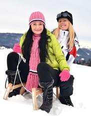 women sledding