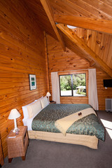 Interior of mountain wooden lodge double bedroom