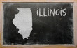 outline map of us state of illinois on blackboard