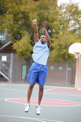 Basketball player tossing the ball