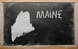 outline map of us state of maine on blackboard
