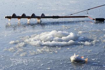 Ice fishing hole and fishing equipment