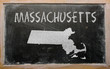 outline map of us state of massachusetts on blackboard