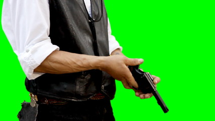 Man with gun on green background