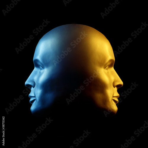 Two-faced head statue, blue and gold