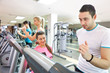trainer instructing man on treadmill