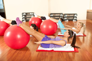 young people doing Pilates exercises