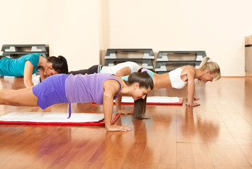 young people are doing push-ups