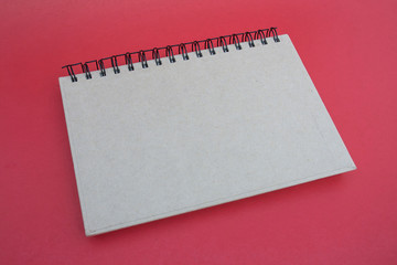 spiral notebook on red background