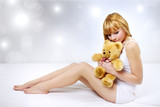 Attractive girl with a teddy bear