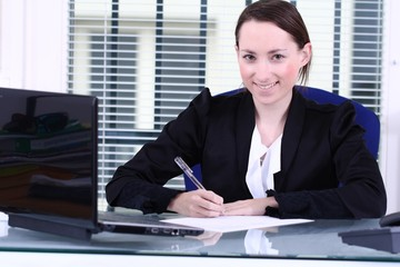 happy young girl signaturing a contract