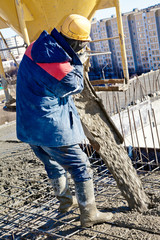 Construction worker during concrete pouring works
