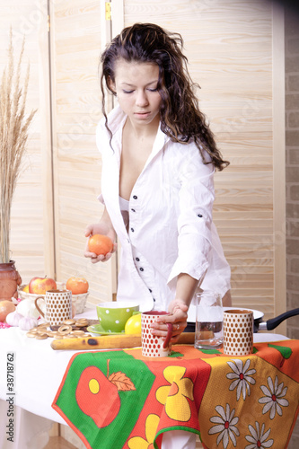 Beautiful woman in kitchen making breakfas