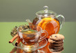 Black exotic fruit tea in glass teapot and cup