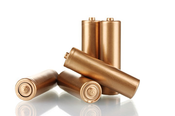 golden batteries isolated on white